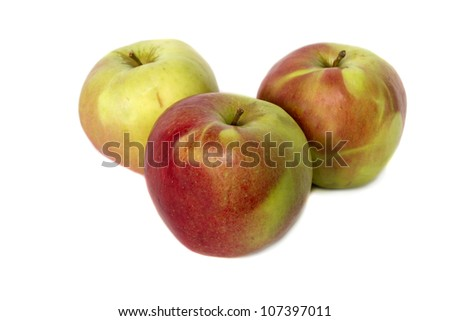Three juicy red and yellow apples on  white background