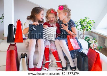 three little cute girlfriends fashioners on shopping