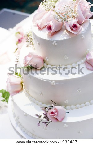 three tier cake with pink roses - stock photo
