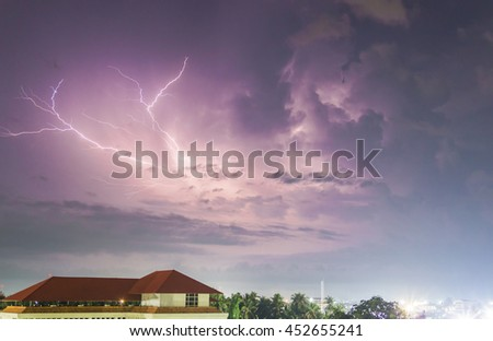 Thunderstorm with huge lightning over night city and blur with long speed shutter