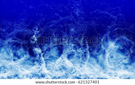 Tide, Blue background with water.