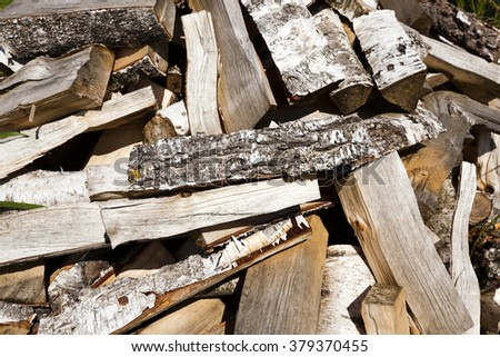 timber harvesting for lighting stoves, harvesting in nature, the old wood - stock photo