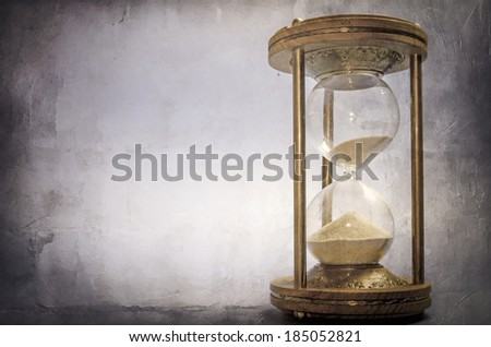 time concept with hourglass lying toned in warm black and white, retro style - stock photo