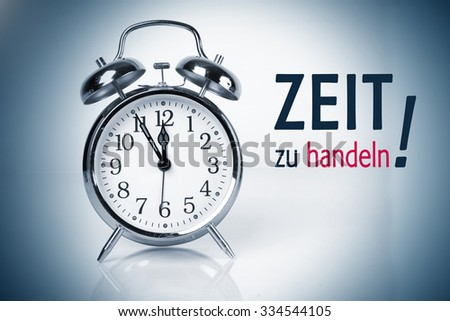 """Time for action, Concept with the German Words """"Zeit zu handeln"""" - stock photo"""