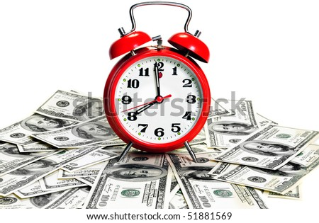 """Time is money"" concept - classic alarm clock over dollars. High contrast - stock photo"