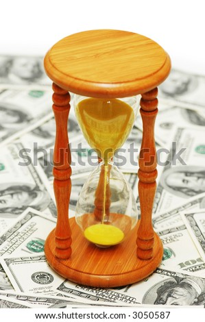 """Time is money"" with dollar notes and  hourglass - stock photo"