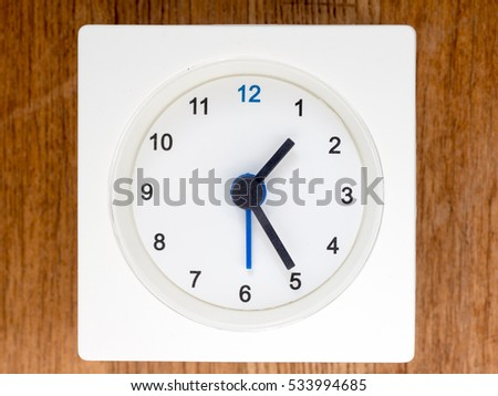 1:25 time on the simple white analog clock