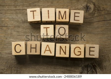 Time to change text on awooden background - stock photo