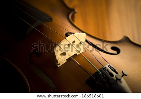 """time to practice violin"" violin in vintage style on wood background - stock photo"