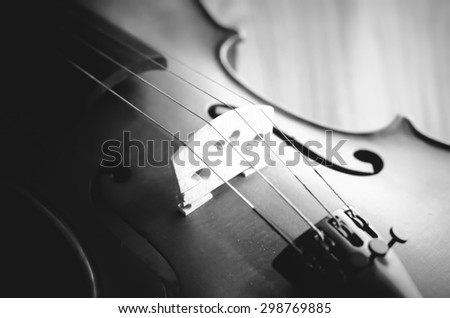 """time to practice violin"" violin in vintage style on wood background black and white color tone style"