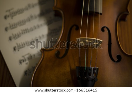 """time to practice violin"" violin with sheet music on vintage style - stock photo"