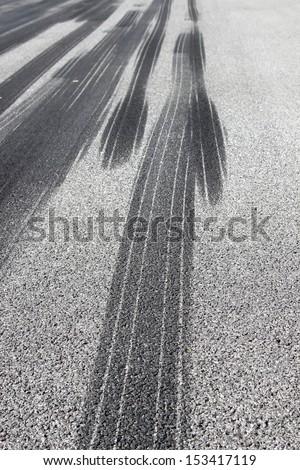 Tire tracks on runway - stock photo