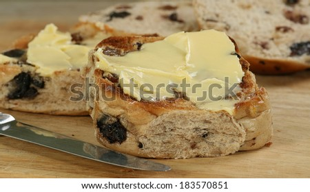 Toasted hot cross bun spread with butter                             - stock photo