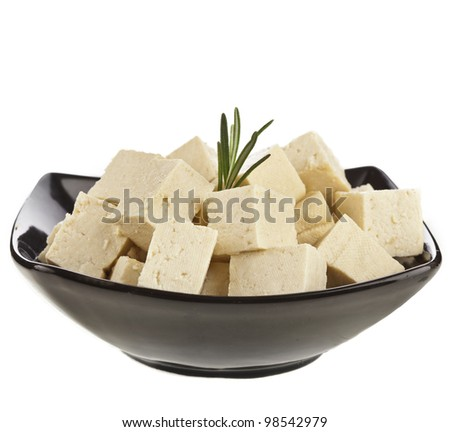 Tofu cubes  on black plate bowl  isolated on white - stock photo