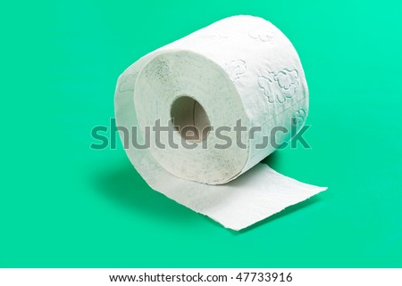 toilet paper on green background