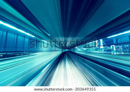 Tokyo automated guide-way train (Yurikamome) at night. - stock photo
