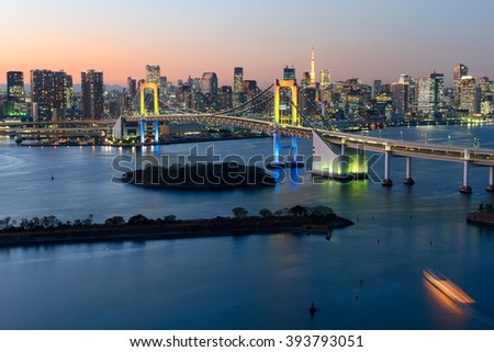 Tokyo Skyline at twilight at the Tokyo Bay,  Rainbow Bridge and Tokyo Tower are visible.  - stock photo