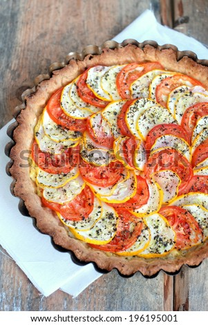 Tomato and zucchini tart with goat cheese, selective focus - stock ...
