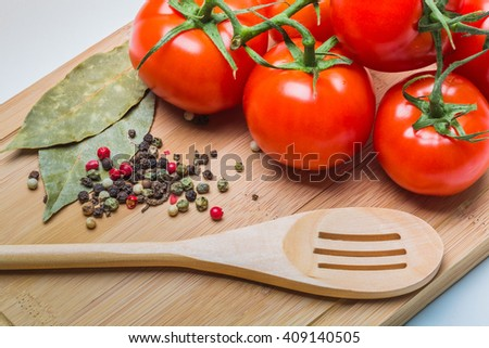 tomatoes and tomato juice on a wooden table - stock photo