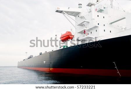115,000 ton oil-tanker moored offshore. - stock photo