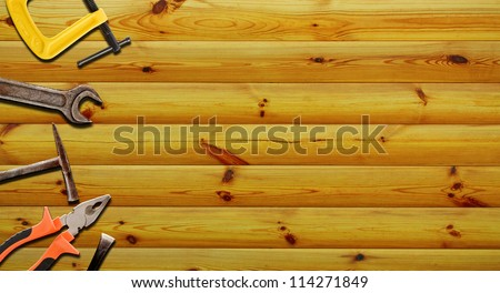 tools for repairs on a wooden background - stock photo
