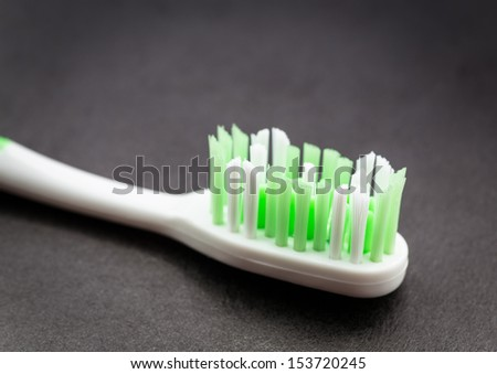 Toothbrush on dark surface.  - stock photo