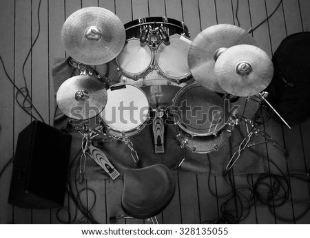 top view of drum set on stage in a concert hall, a concert musician playing instrument, rock and roll concert concept, Music band and song business. - stock photo