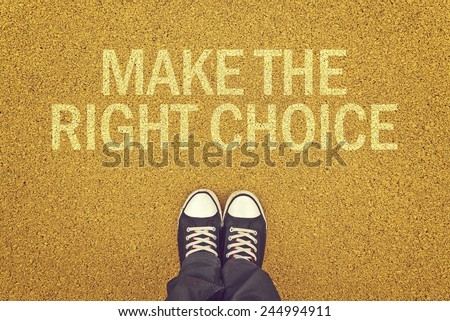 Top View of Man standing at yellow asphalt pavement with Make The Right Choice Title - stock photo