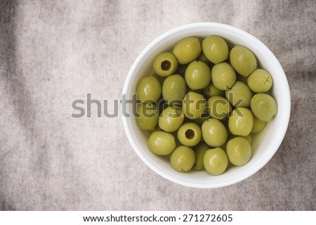 Top View Of The Green Olives In White Bowl - stock photo