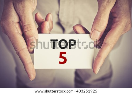 """"""" TOP 5 """" word on card hold by man - stock photo"""