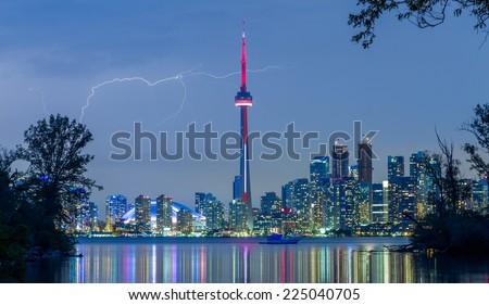 Toronto Downtown Skyline at night with lightning - stock photo