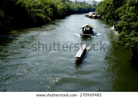 Tourists on a boat at the river Kwai  in Kanchanaburi,Thailand                - stock photo