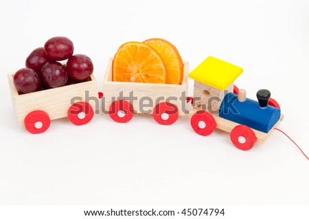 toy train with fruits on white - stock photo