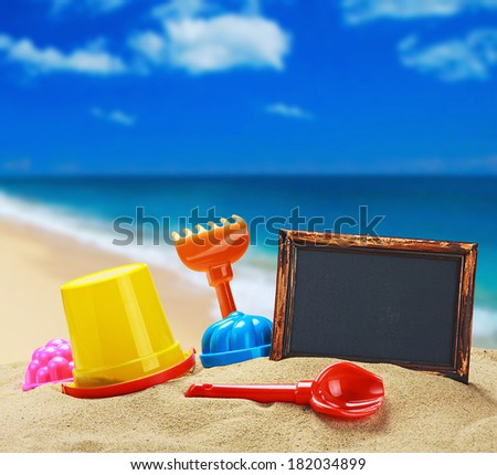 toys for childrens sandboxes against the sea and the beach - stock photo