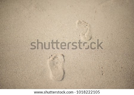 traces of feet on the  sand.selective soft focus.