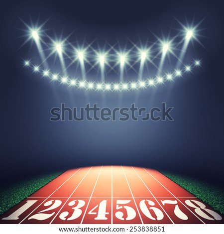 Track lanes and floodlights , Athletics event , Track and field stadium - stock photo