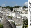 traditional architecture of  Alberobello, Unesco list, Apulia, Italy - stock photo