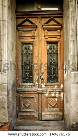 traditional beautiful wooden old door - stock photo