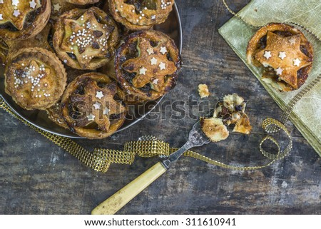 Traditional homemade Christmas mince pies on old rustic wooden table  - stock photo