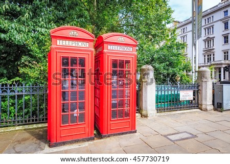 Traditional Red telephone boxes on street in London.  - stock photo