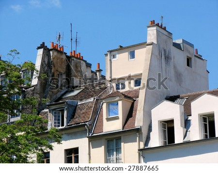 traditional tile roof and house attic in paris, france