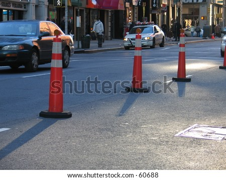 3 Traffic Cones in NYC - stock photo
