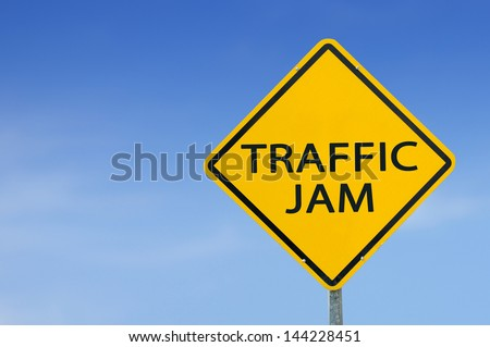 """""""TRAFFIC JAM"""" traffic sign with blue sky - stock photo"""