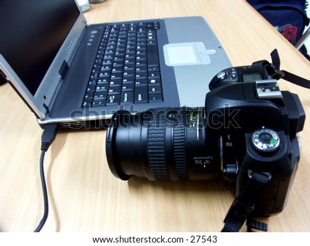 """""""Transfer Photos from Camera to the laptop/notebook"""". - stock photo"""