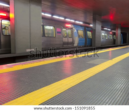 Transport - Underground station - moving train - starting - yellow line to guidance blind people - Rio de Janeiro - stock photo