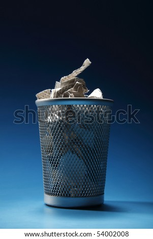 trash bin  on the blue background - stock photo