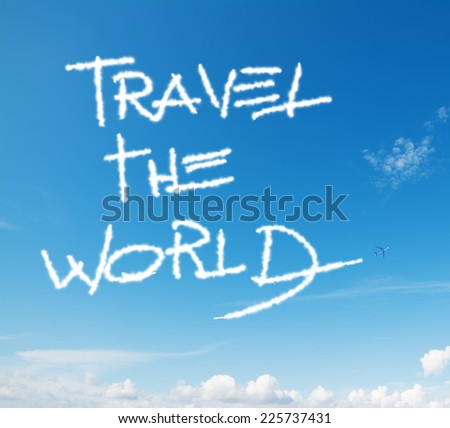 """travel the world"" written in the sky with contrails left by airplane - stock photo"
