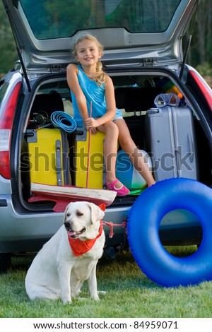 Travel,Vacation - Girl with dog ready for the travel for summer vacation - stock photo