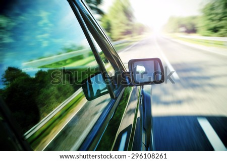 travelling over on landscape background. - stock photo