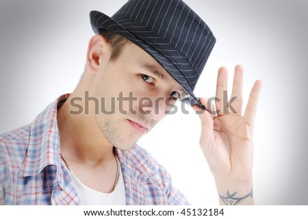 Trendy handsome young man with hat, isolated on white background
